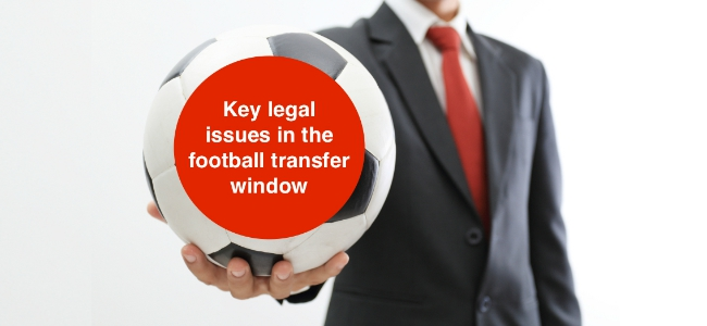 Businessman holding a soccer ball on white background key legal issues