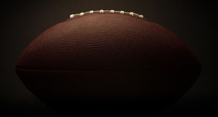 American football on dark background
