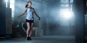 Woman using skipping rope