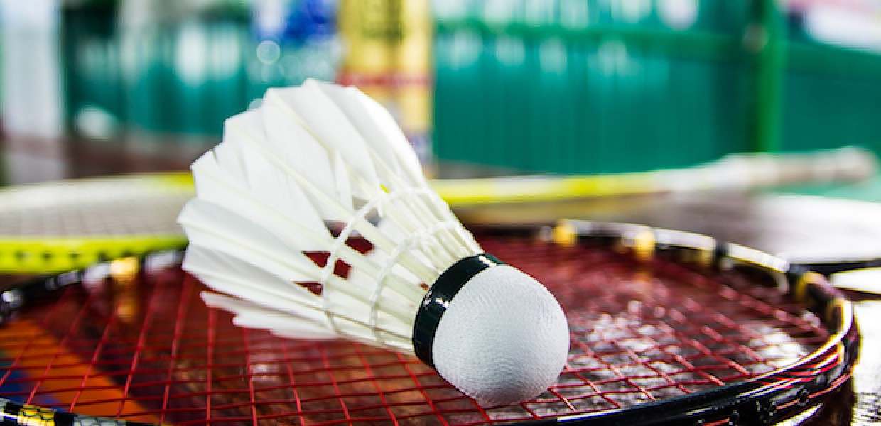 Badminton shuttle on racket