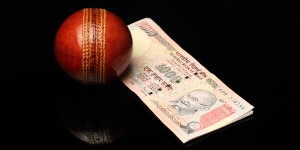 Cricket Ball next to cash