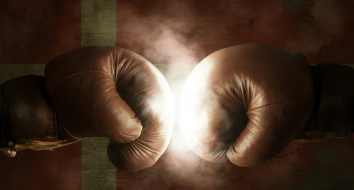 Boxing gloves in front of Denmark flag