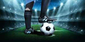 Foot_on_Football_In_Stadium