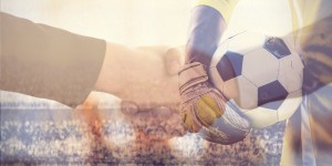 Football goalkeeper on handshake background
