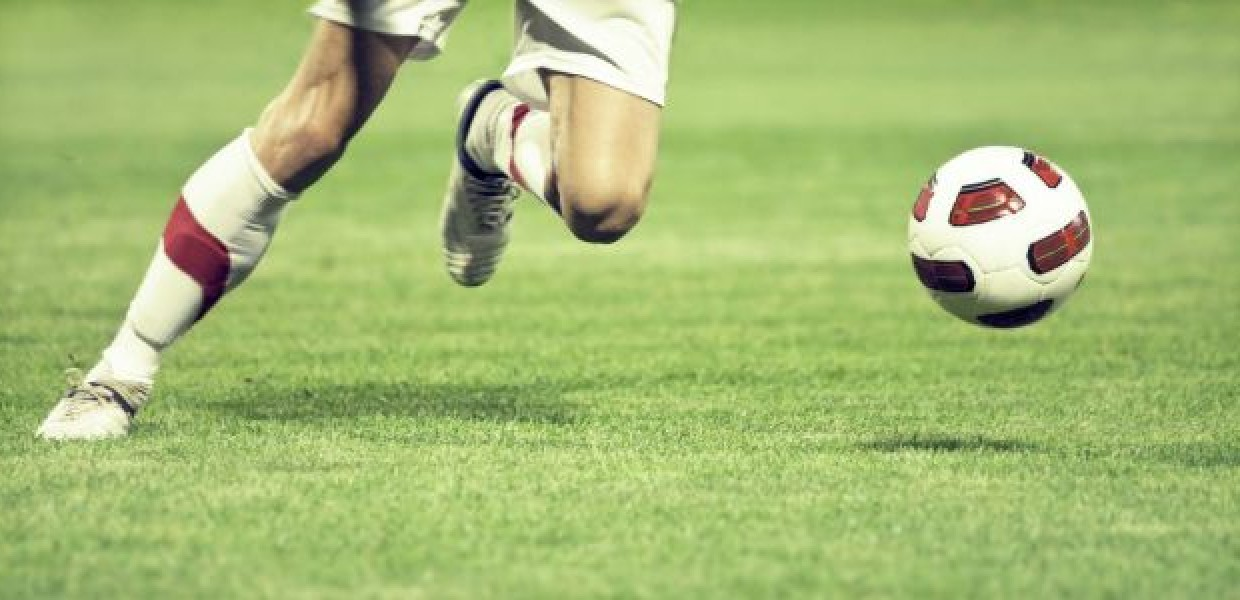 Footballer_with_White_Boots_going_to_Kick_Ball