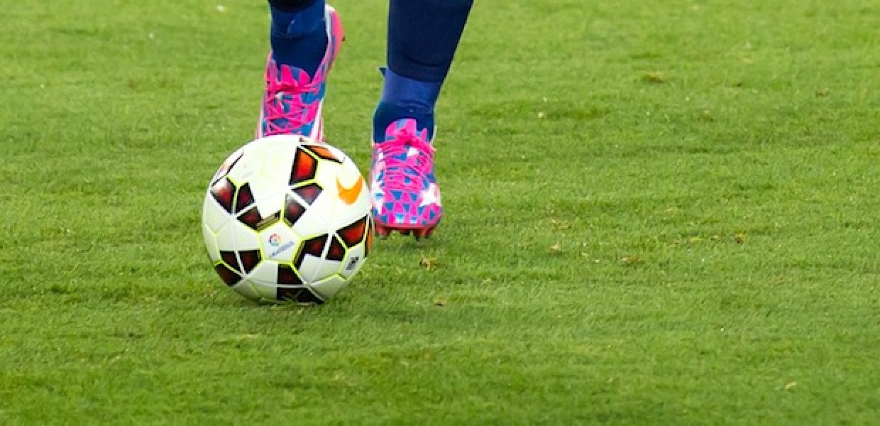 Football with Pink Boots