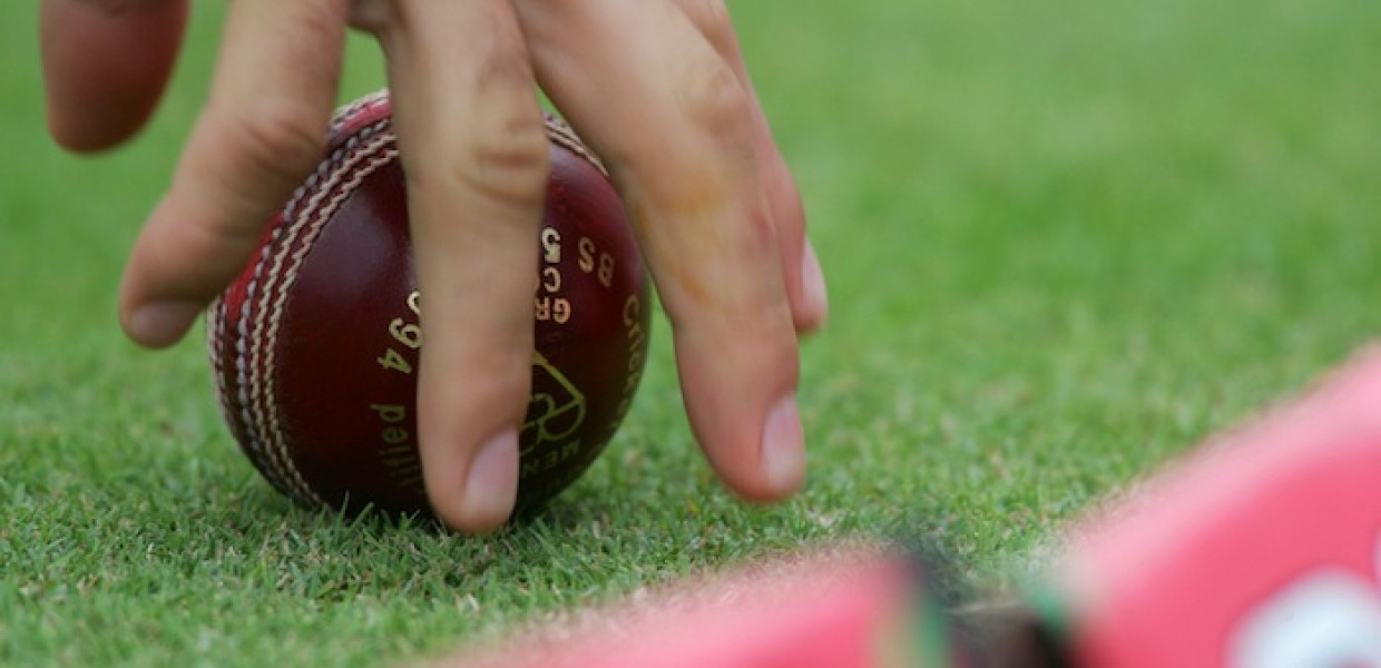 Hand on cricket ball