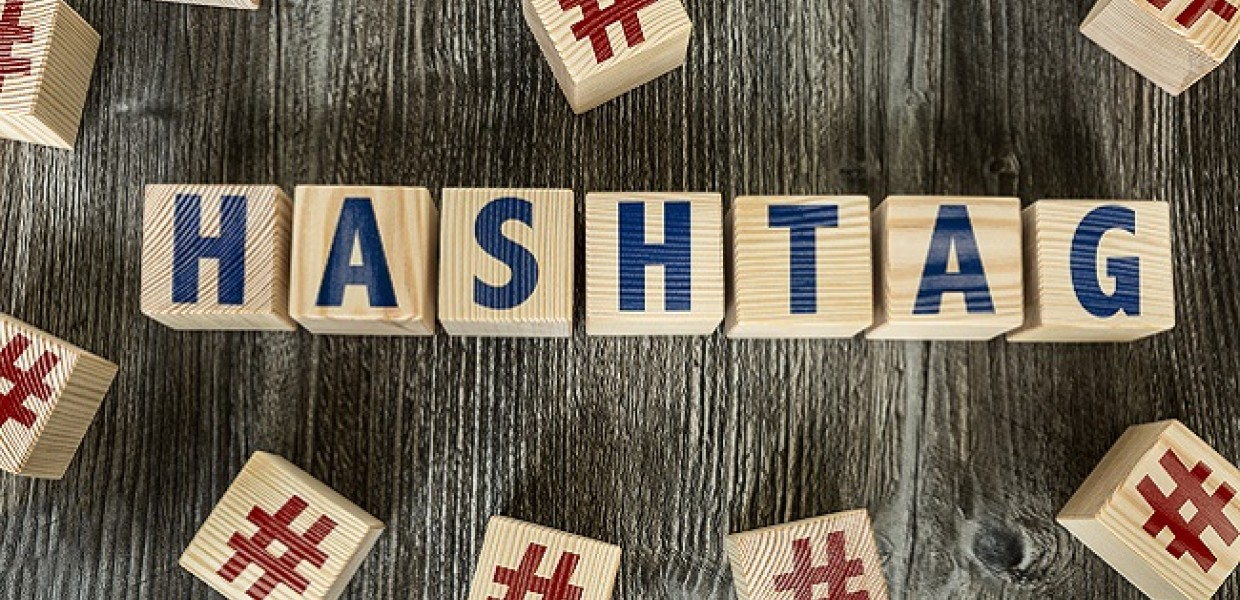 Hashtag text on wooden blocks on top of wooden table
