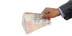 Indian_Rupees_spread_in_hand