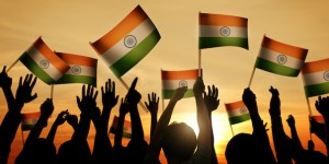 Indian flags waving in front of sunset