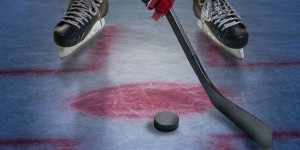 Legs_of_Hockey_Player_and_Puck