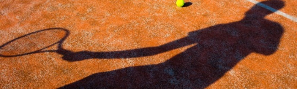 Shadow_of_Tennis_Player_on_Court