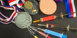Syringes in medals on desk