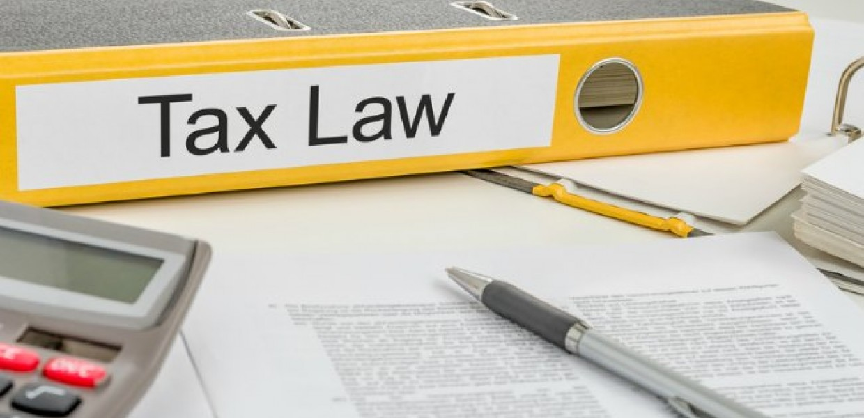 Tax_Law_on_Yellow_folder_with_paperwork