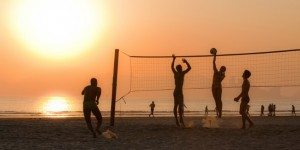 Volleyball_being_played_on_Beach_at_Sunset