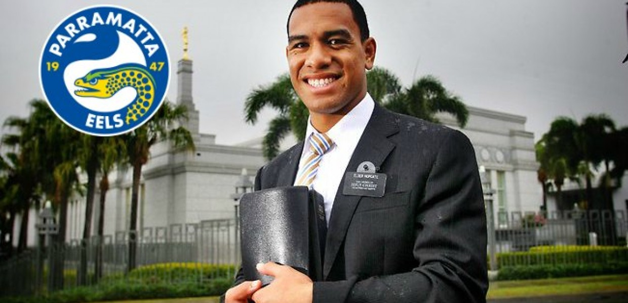 William_Hopoate_Holding_Book_and_Parramatta_Eels_Logo