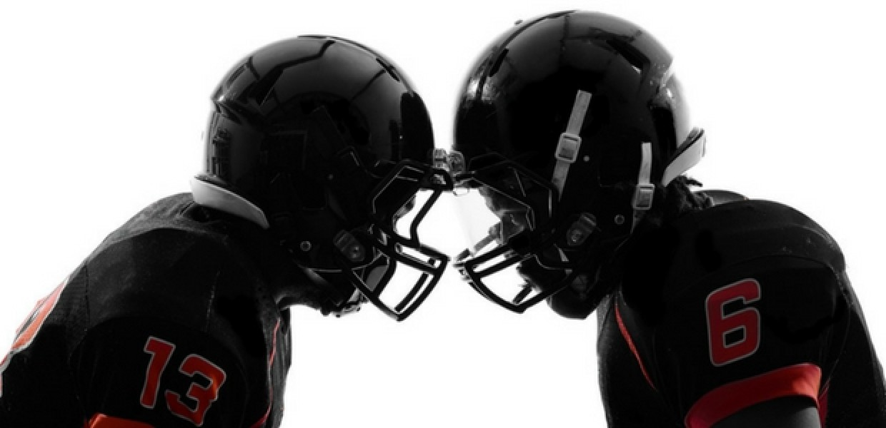 American football players in helmets