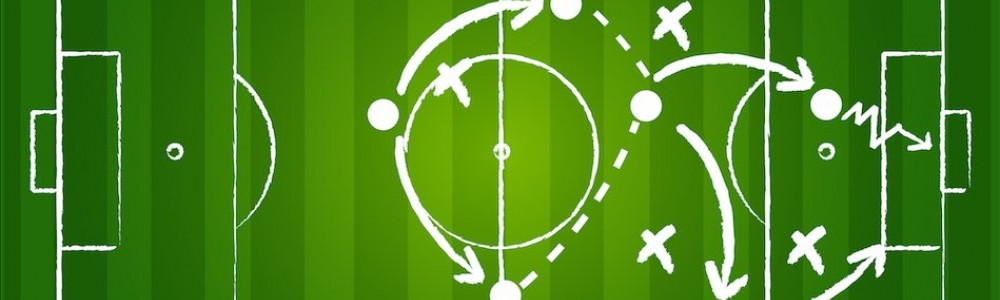 Image of football strategy drawn on pitch